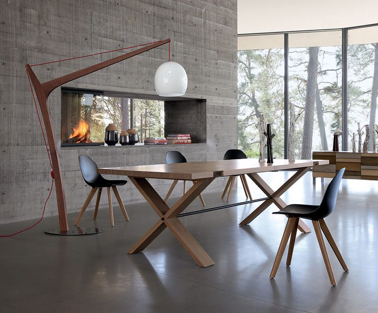 Large solid oak cross leg dining table with eames style chairs