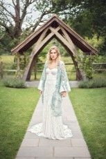 British bohemian wedding inspiration with Rue de Seine 'Arrow' boho lace wedding dress from luxury bridal boutique Leonie Claire in Brighton. With aquamarine embellished couture mermaid style wedding kimono opera coat from Jesus Peiro. With tousled natural wedding hair and strong bohemian make up with dark berry lip.