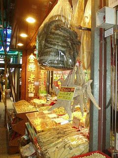 Bags of sea snake and dried starfish for sale in a Hong Kong food market (photo by Simone Cannon)