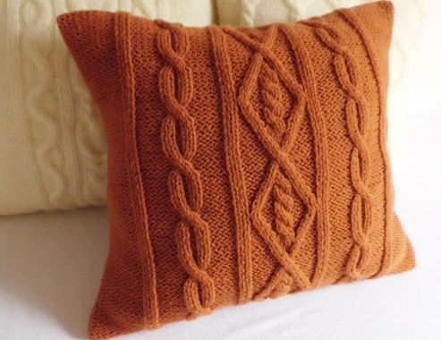 This listing is for a custom terracotta pillow cover with intricate cable knit designs.The warm fall sun color of the pillow would be a perfect