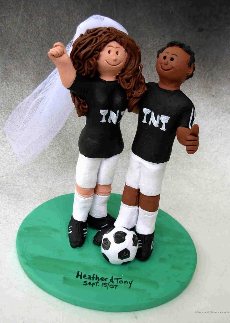 Mixed Race Wedding Cake Topper....  Its a multi-cultural society we are living in....and often it's difficult to find a wedding cake topper that reflects this diversity. Not so here, where every figurine is hand made to your specifications....so let us know about the ethnicity of the couple and any other details that you may wish to include...  $235 #interracial#wedding#cake#topper#soccer#mixed_race#bride#groom#anniversary