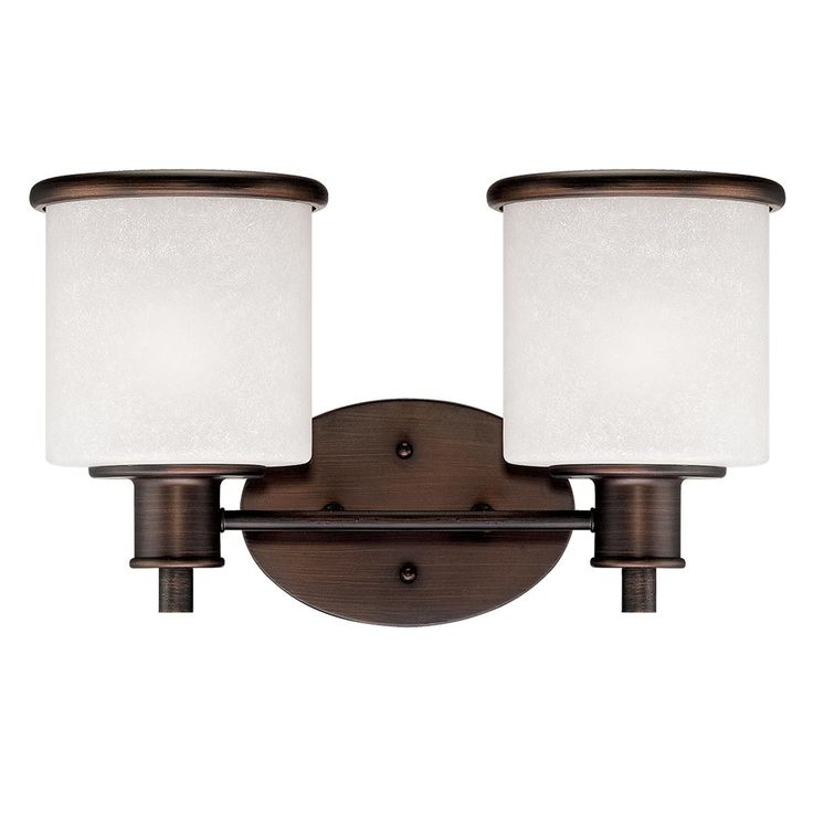 Urban Carafe Bath Light 2 Light Scavo glass drum shades and bronze Craftsman hardware make this 2 light bath fixture a must have beside Mission style mirrors and over dark stained vanities