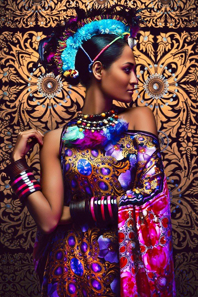 Love this gorgeously wild color palette -that feathered mohawk...headdress? hat? It's amazing! Must remember to look up info on this designer.