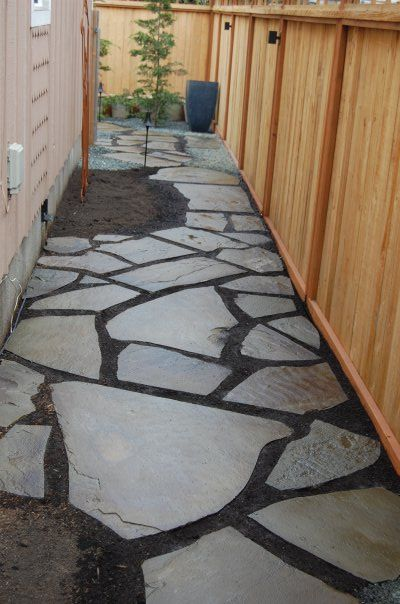Hand cut Bluestone used to create a natural pathway along a narrow sideyard. Design and Installation by Everything Outdoors Landscape & Construction LLC Portland, Salem, Bend Oregon