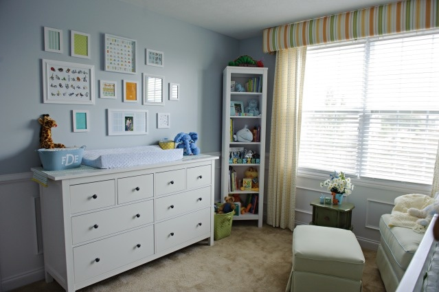 Love the Ikea Hemnes Dresser with changing pad on top, also love the print collage on the wall.