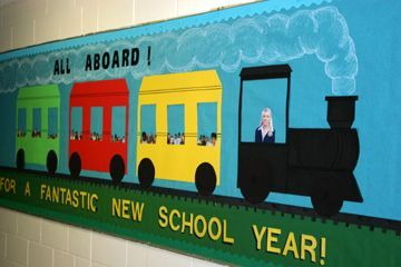 Welcome Back to School Train Bulletin Board. Would be cute to add faces of your kids in the windows.
