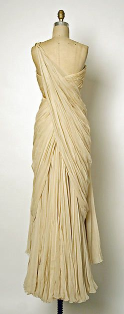 ADDITIONAL IMAGES (4) Evening dress Designer: Jean Dessès (French (born Egypt), Alexandria 1904–1970 Athens) Date: 1949–50 Culture: French Medium: silk Dimensions: Length at CB: 49 1/2 in. (125.7 cm) Credit Line: Gift of Mr. and Mrs. Jeffrey Paley, from the Collection of Dorothy Hirshon, 1999 Accession Number: 1999.472