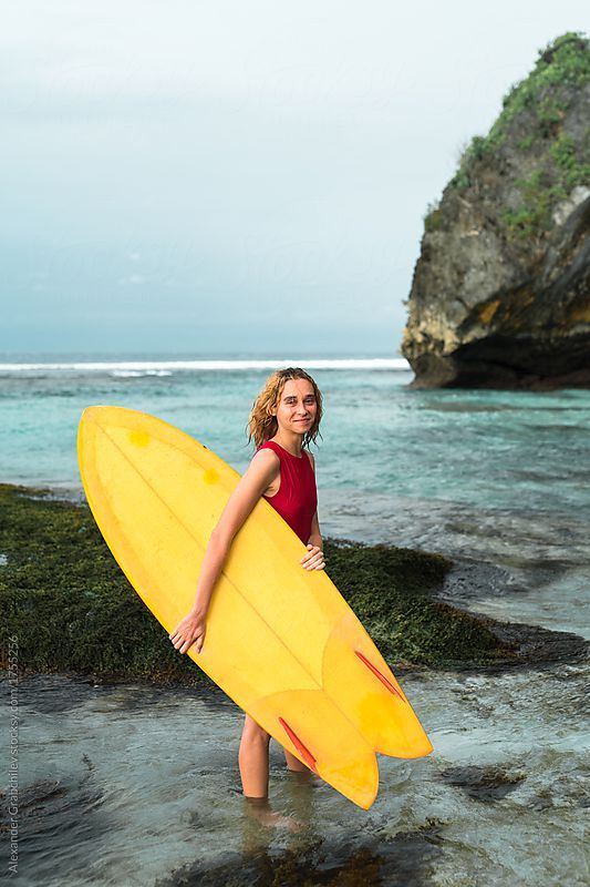 #Woman in #red swimsuit with #yellowgold fish #surfboard #surfing at #wild #tropical #beachlife
