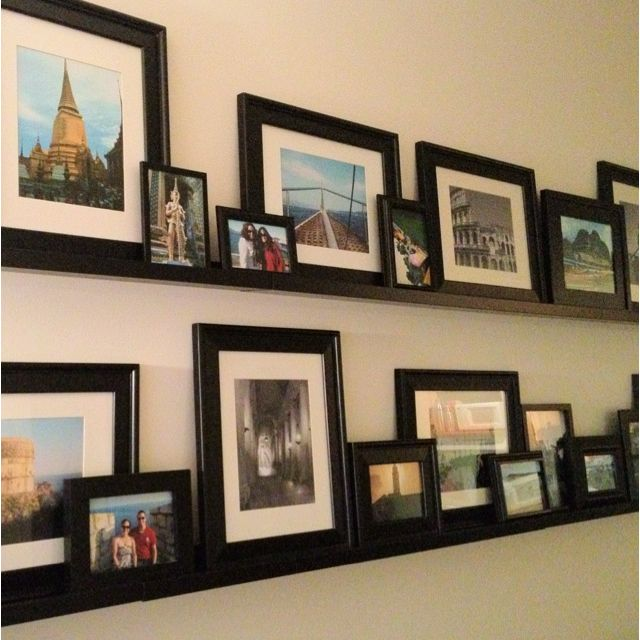 My gallery wall with travel photos. Pottery Barn was my inspiration, but I used IKEA shelves instead to save big money!