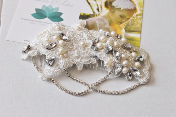 Crystal and pearl vintage inspired Gatsby bridal headpieceThis striking vintage inspired headpiece features gorgeous crystal rhinestones, fresh water pearls and seed beads. All of the components have been meticulously hand sewn onto the ivory lace to create this stunning bridal headpiece.The crystal chain cascades down for an elegant Gatsby look.This lovely headpiece will add a touch of sparkle and elegance on your special day. Attaches with silver plated combs.Materials--Ivory lace…