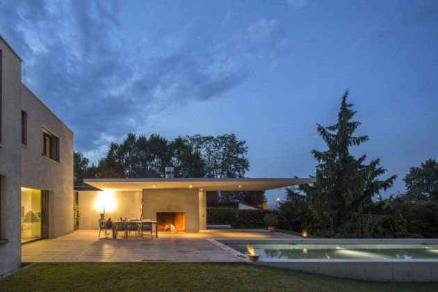 chic house exterior design idea equipped with green view in haus von arx finished with modern swimming pool design