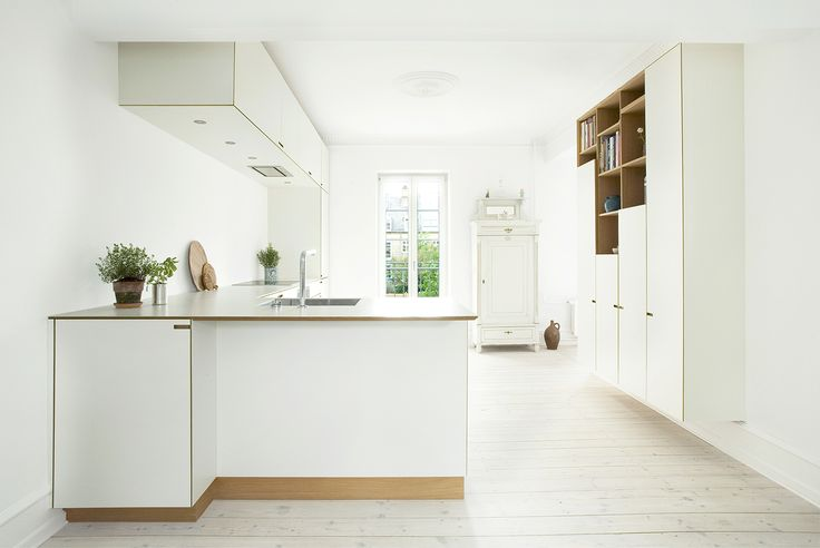Our bespoke kitchen at Kildevældsgade. The choice of white laminate combined with oak gives this kitchen a discrete atmosphere, maintaining warmth with the tactile details in the wood. #scandinavian #kitchen #minimalism #nicolajbo