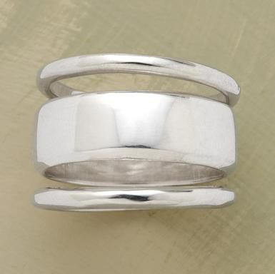 One weighty handcrafted sterling silver band and two slender companions to stack or divvy up as desired. Set of 3