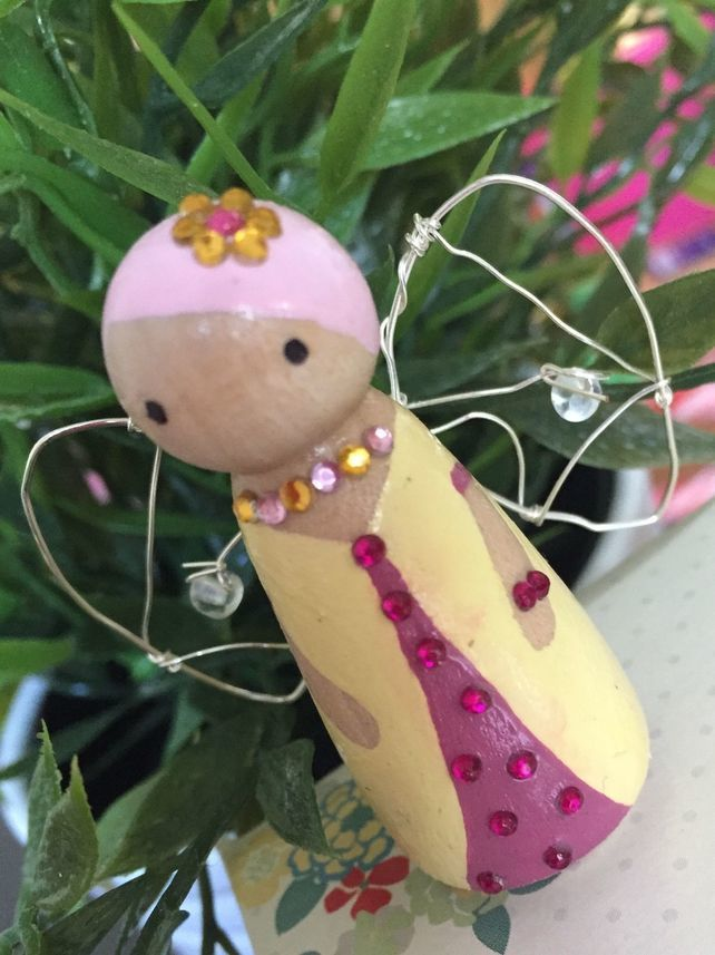 Pink and yellow wooden peg fairy with wings