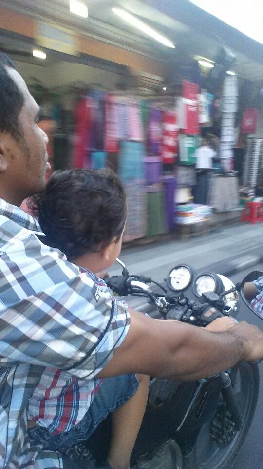 M riding motorbike with wind in his hair! Legian, bali