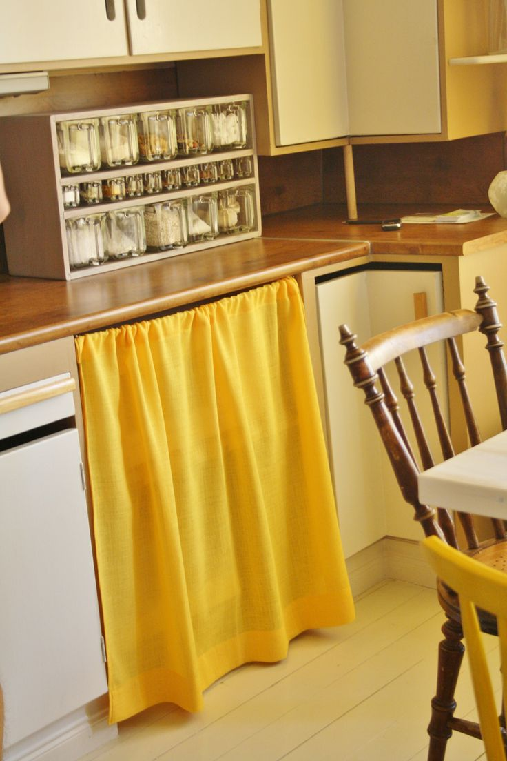 Curtains covering the lower kitchen cabinets