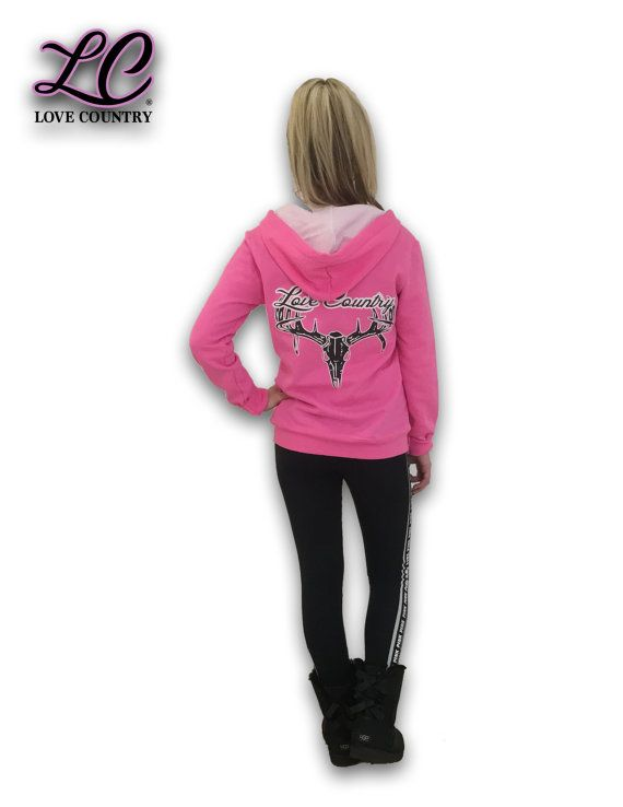This item is a featured preview of a new family branded clothing company coming out of the Northern California Mountains. Love Country Clothing brand seeks to contribute to society by way of donations, volunteer work and spreading awareness about important matters.  The fitted, soft pink hoodie features the Love Country Clothing Co. trademark in a classic black and white contrast. The hoodie is form-fitted and has a white drawcord, hood lining and zipper for the most comfort and convenience…