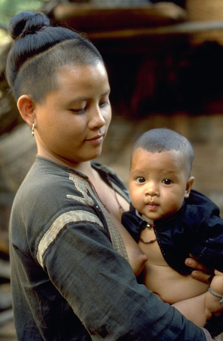 Black Lahu tribe mother, Thailand by john spies