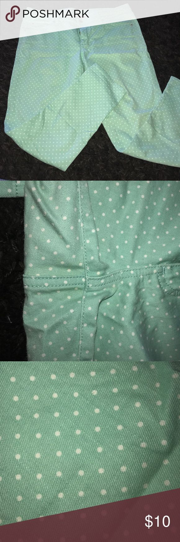 Merona Mint polka dot jeans Pre-love mint jeans. Slight pilling in crotch see photos. Tan thread from sales tag easily cut off I'm just lazy. Not sure of the cut I'd say closer to a skinny jean but not skinny to the ankle maybe straight leg? Stain on front right have not tried to clean. Merona Jeans