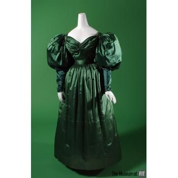 The Museum at FIT - Green silk satin dress c. 1830—but no, those are not leg-of-mutton sleeves.  That's a later term.  Check out the sleeve close-up.  And imagine this with lots of accessories.
