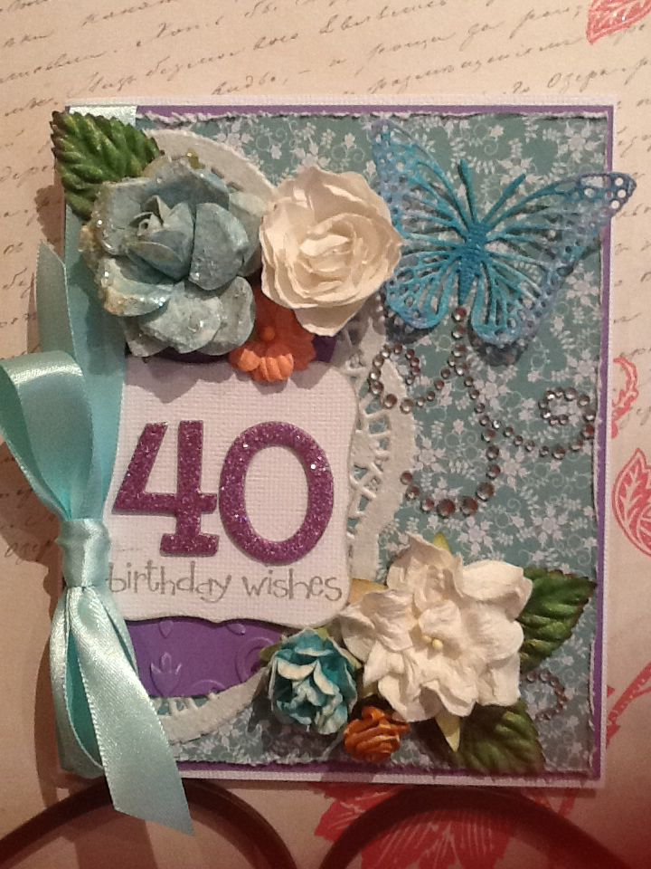 40th birthday card. Doily, satin ribbon, diecuts, flowers and leaves, painted butterfly with bling swirls. White, teal and purple for this custom order.
