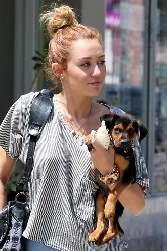 Miley Cyrus and her dog Happy