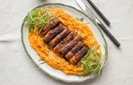 Crispy pork belly and pumpkin mash dusted with black sesame