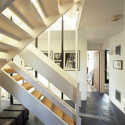 70s staircase by jamesbalston, via Flickr  white beam, grey floor, open wood stairs with painted under side and front overhang