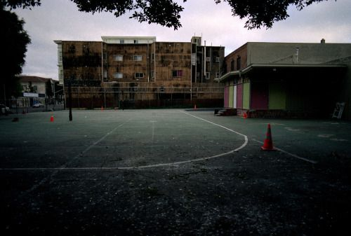 The Schoolyard by Marquis HoughtonI saw this scene last week in Oakland. The mood was depressing and dark and gray as it wore into the evening. Walking towards Chinatown I came across this school and immediately hoped that it was abandoned. It feels like a scene out of a zombie apocalypse movie. Depressing to say the least. Shot with Portra 400 and Canon EOS 3 with 24mm.