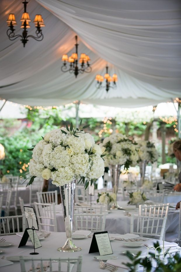 Beautiful Blooms - Tall White Hydrangea and Rose Centerpiece with Touches of Seeded Eucalyptus