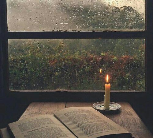 Rain and books by candlelight. Gorgeous.