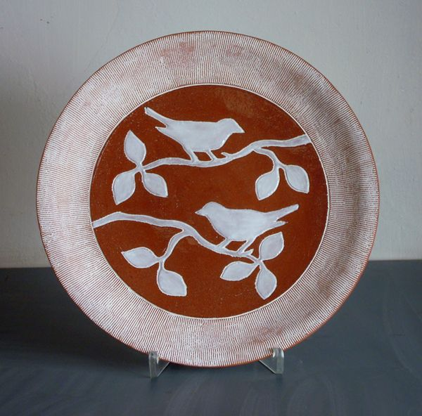 Plate terracotta and white bird