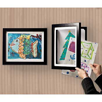 {Dynamic Artwork Frame} SooooOoOOOO cool.  Features: -Opens like a cabinet -Displays one picture in front; stores up to 50 behind it