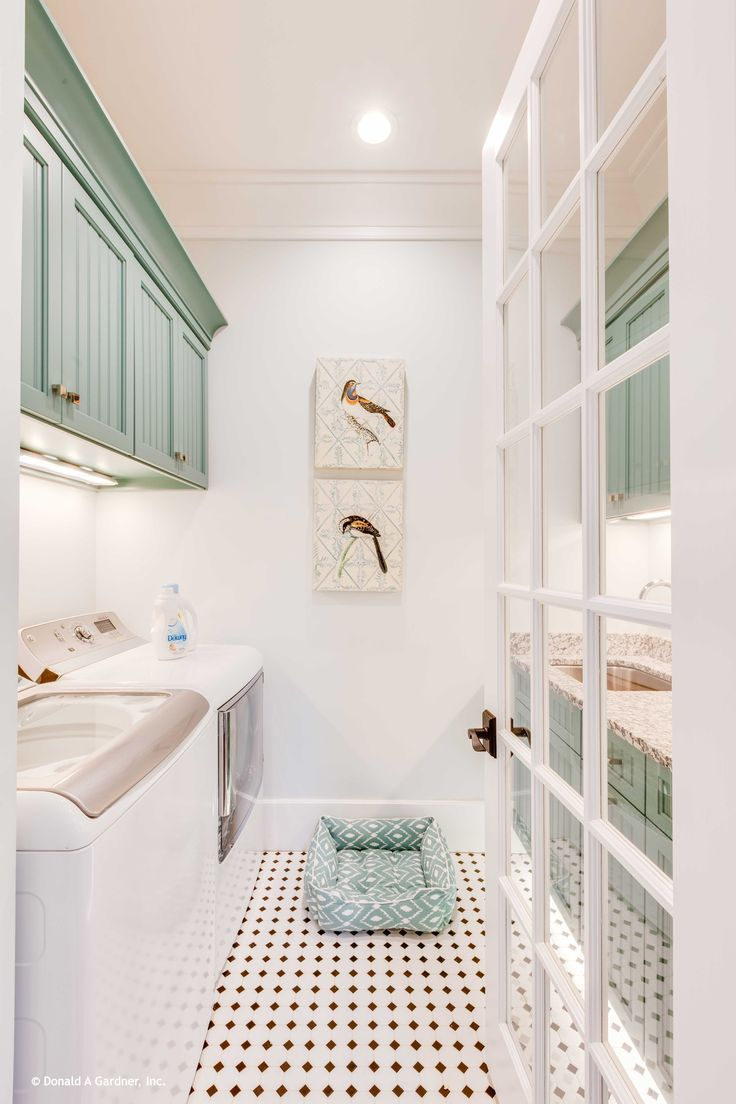 A French Door Allows View Into This Light And Bright Laundry Room