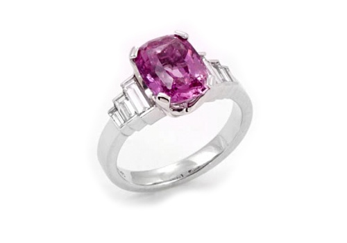 Pink cushion sapphire in centre with tapered baguette diamonds on sides. Model 	: 	Pink Cushion Sapphire