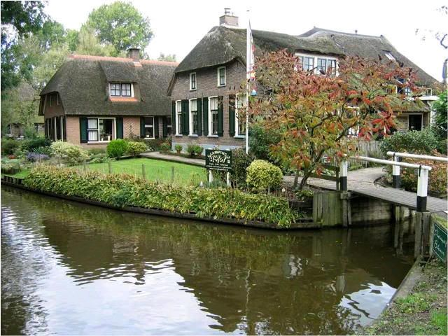 """One of the houses in Giethroon, Holland. This entire town does  not have roads; instead buildings are connected by waterways and tiny paths for walking (and some biking). The main form of transport is the noiseless """"Whisper boats"""". Imagine spending a day or two here."""