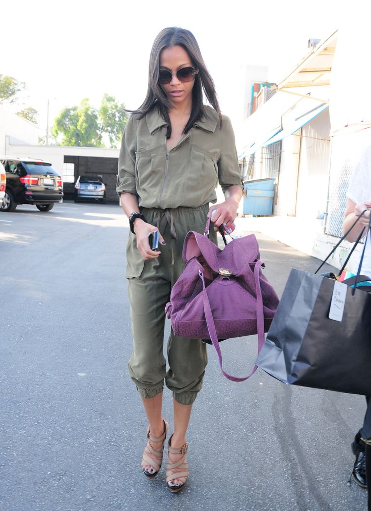 Zoe's army-colored silk jumpsuit is part utilitarian and part chic. Her purple handbag added the perfect pop of color to her LA mix.  Get a similar utilitarian jumpsuit here.