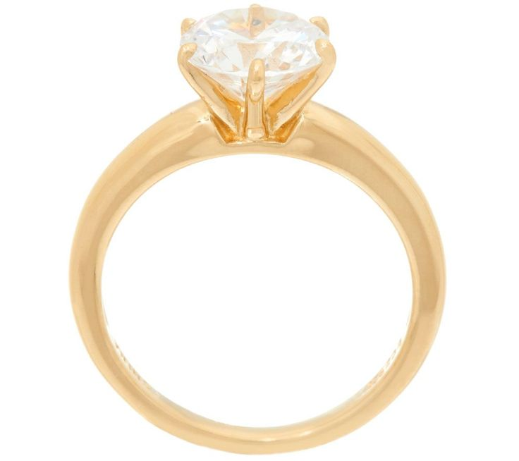 The one. A single Diamonique(R) simulated diamond beckons from atop this gorgeous Epiphany ring. Crafted of 14K yellow gold-clad sterling silver,the rounded band is a sleek foundation for the stunning sparkler.<br><br>Round, Cushion, Princess, Emerald, Asscher, Oval, Marquise, Pear, or Heart.<br><br>For more details on this ring's fit, please refer to the Ring Size Guide above. QVC.com