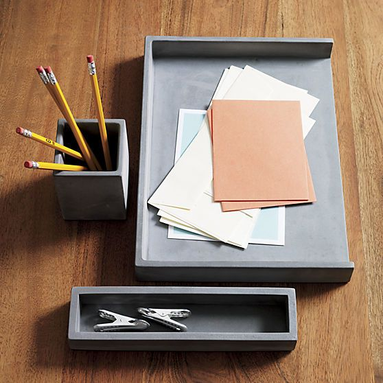 cement desk accessories | CB2  Letter tray, pencil cup and catchall cement an industrial spot for papers, pens, clutter and office supplies. Honed smooth in matte grey with natural intonations, concrete works a minimalist architectural touch in the office.