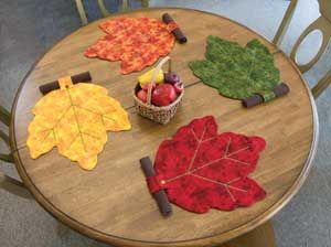 "AUTUMN LEAVES PLACEMAT ~ what fun is this! The ""stems"" hold the napkins…"