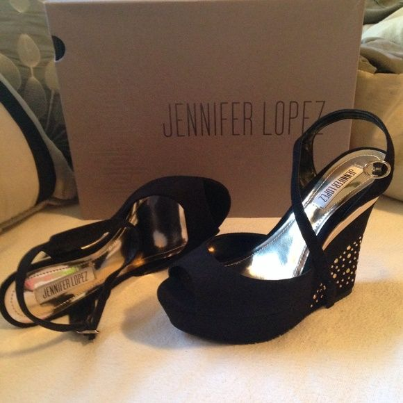 Jennifer Lopez Black Peep Toe Wedges  Black suede Jennifer Lopez wedges. Gold gem accents on the heels with gold trim at the top and a black strap around the ankle. Wedge measures aprox 5 inches. Comes with original box Jennifer Lopez Shoes Wedges