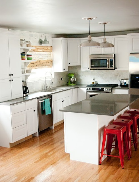 This is kinda like how I want our kitchen to look. grey quartz countertops and white cabinets almost to the ceiling. I want white subway tile backsplash.