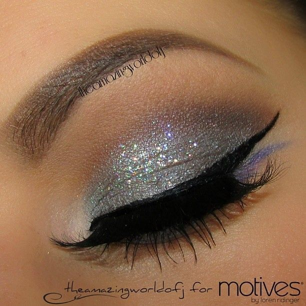 Silver sparkly eyeshadow with slight crease definition and thick black winged liner - party make up or for shows...x