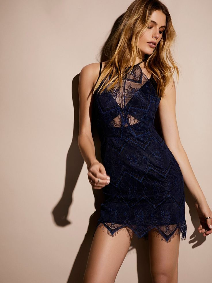 Nothing Like This Mini Dress | Vintage-inspired sheer lace mini dress featuring an uneven hem with eyelash lace trim.      * Halter neck with button closure.    * Built-in slip with cutout detailing at the midriff.     * Low back with crisscross straps.    * Hidden side zip closure.