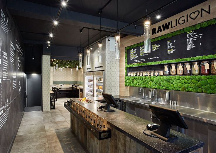 """Design studio Mystery has created the branding and interiors for a new health-food restaurant in London. Rawligion is a """"plant-based café"""", which uses organic, locally-sourced fruit, vegetables, seeds, herbs and spices to make lunch dishes, juices and smoothies, desserts and snacks. The design concept for the interiors has been inspired by the Apple store and …"""