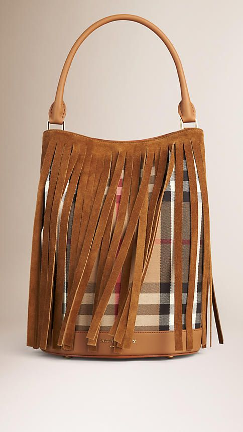 Burberry Dark Sand The Bucket Bag in House Check and Fringe - A bucket bag crafted from House check with a suede fringe overlay. The structured design features a flat base, pinch-pleated sides and a rolled leather handle. Interior zip and pouch pockets and a detachable wristlet complete the piece. Discover the women's bags collection at Burberry.com