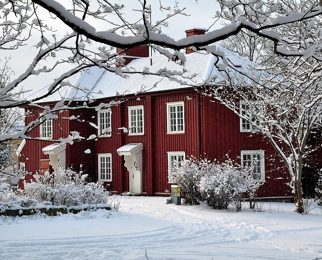 A traditional Swedish house in red and white in wintertime