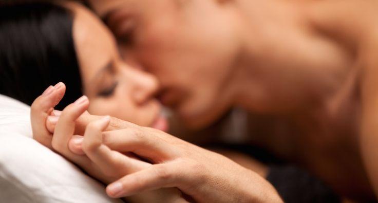 A couple embraces (Shutterstock)
