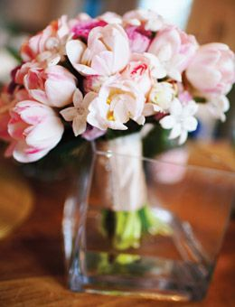 Brides: Tulip and Stephanotis Wedding Bouquet. Logan's pink-and-white bouquet combined tulips, roses, hydrangeas, and stephanotis studded with crystals and was designed by Nouveau Flowers.