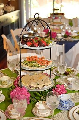 Mixed China and fresh flowers with chocolate dipped fruit, little tea sandwiches and crudettes on a tiered stand.